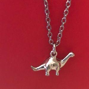 Dinosaur silver tone necklace
